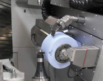 Workspace of a gear grinding machine. Very high rotational energy levels can arise in large grinding tools, such as those used for generation grinding. If a grinding wheel does burst, it can cause serious injury to the machine operator. Source: Kapp